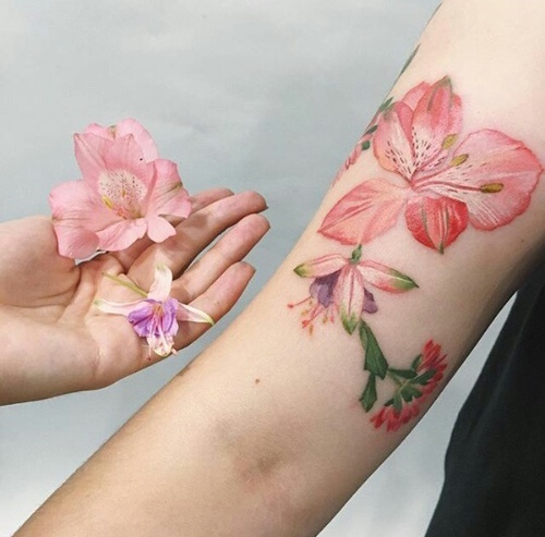 10 perfectly pink tattoos tattoo here is a pink floral tattoo that is both feminine and strong and very eye catching mightylinksfo