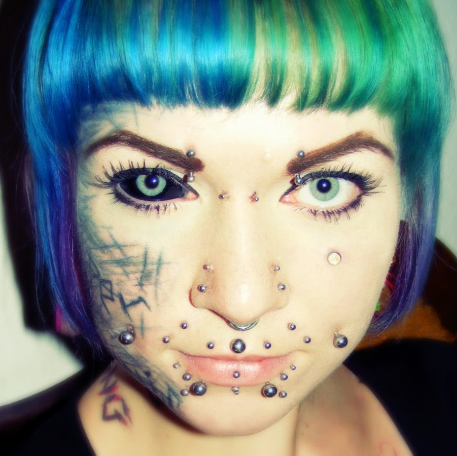 Extreme tattoos and piercings for lovely